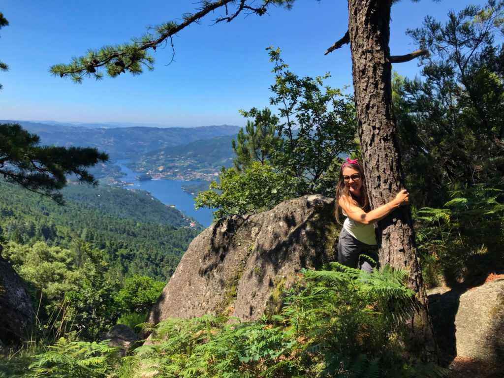 Hugging trees in the Peneda-Geres National Park, Portugal - Experiencing the Globe