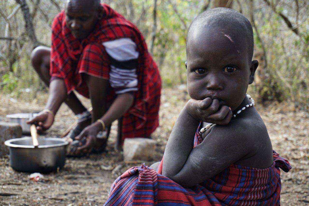 Masai child during the medicinal rite, Tanzania - Experiencing The Globe