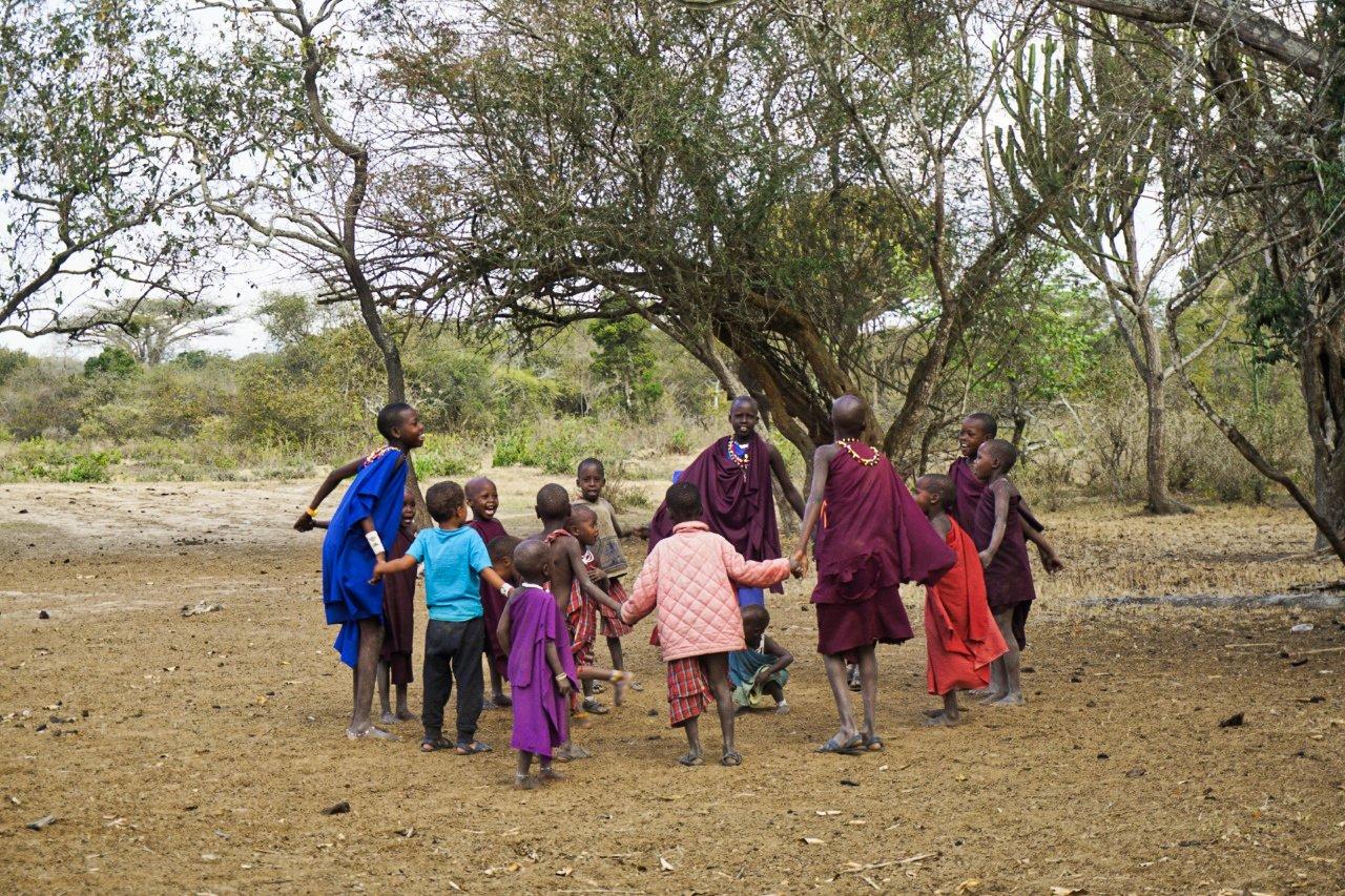 Masai children singing and dancing, Tanzania - Experiencing The Globe