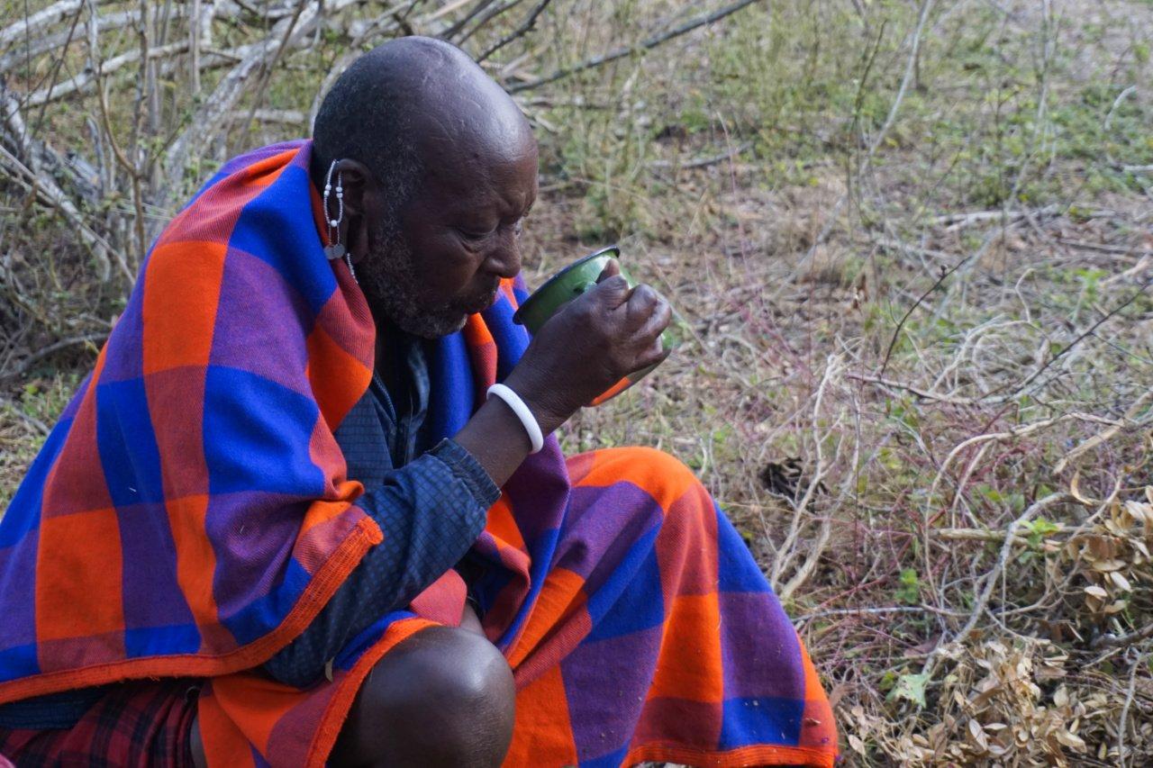Patriarch of the Masai boma during a medicinal rite, Tanzania - Experiencing The Globe